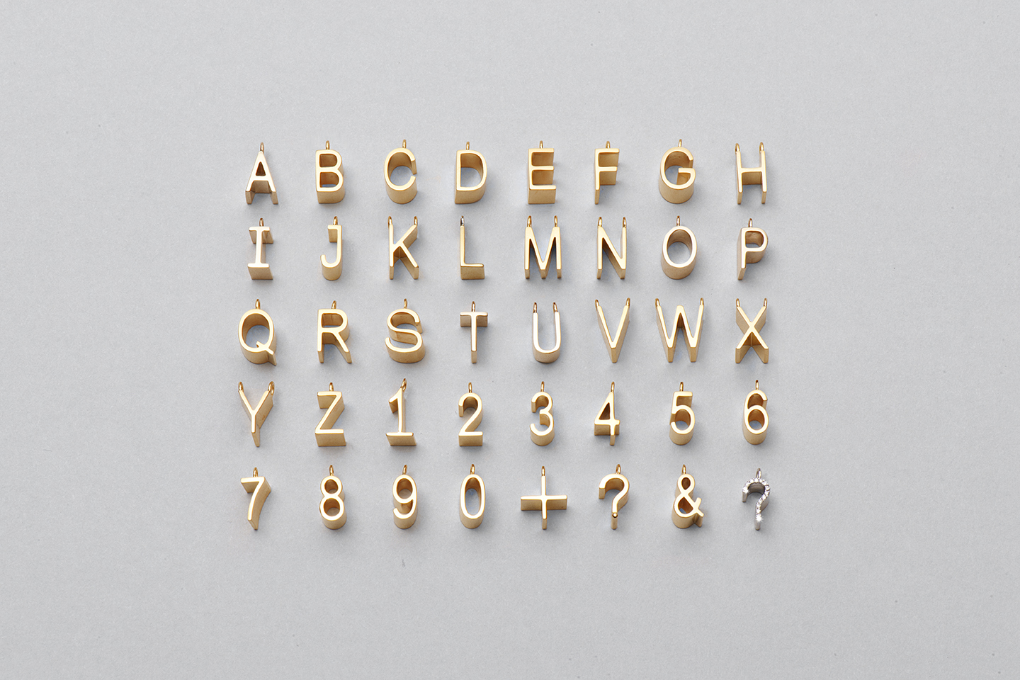 Alphabet Series in 18kt Yellow Gold. Image Courtesy of J Rabun