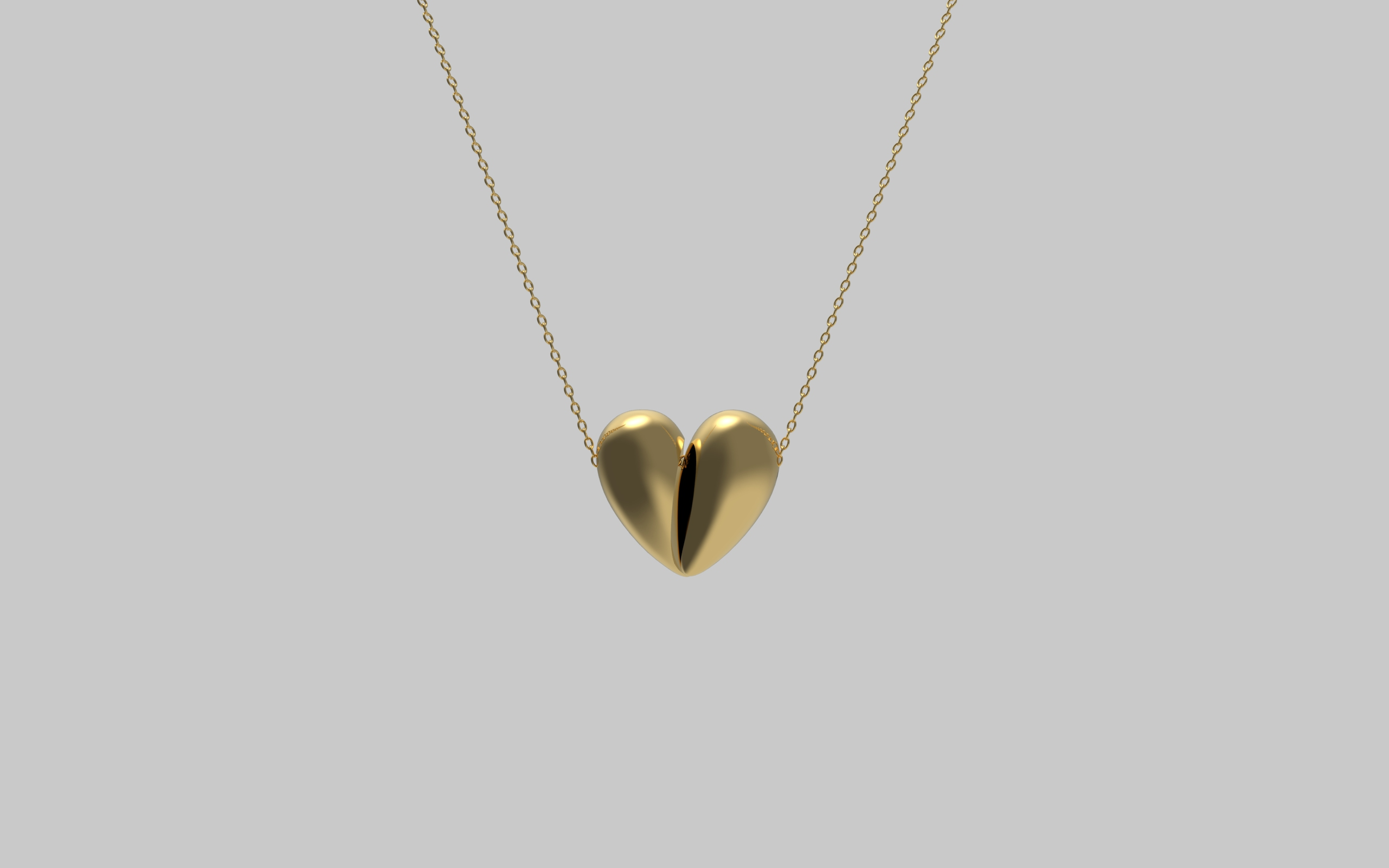 Black Love Pendant in 18kt Yellow Gold. Image Courtesy of J Rabun