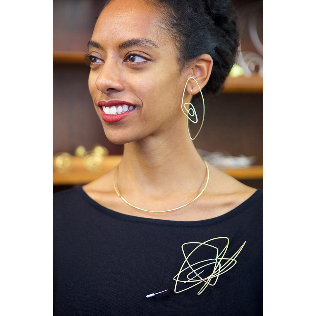 Chaos Brooch and Earrings in Fairtrade Gold. Image: Jamie Trounce