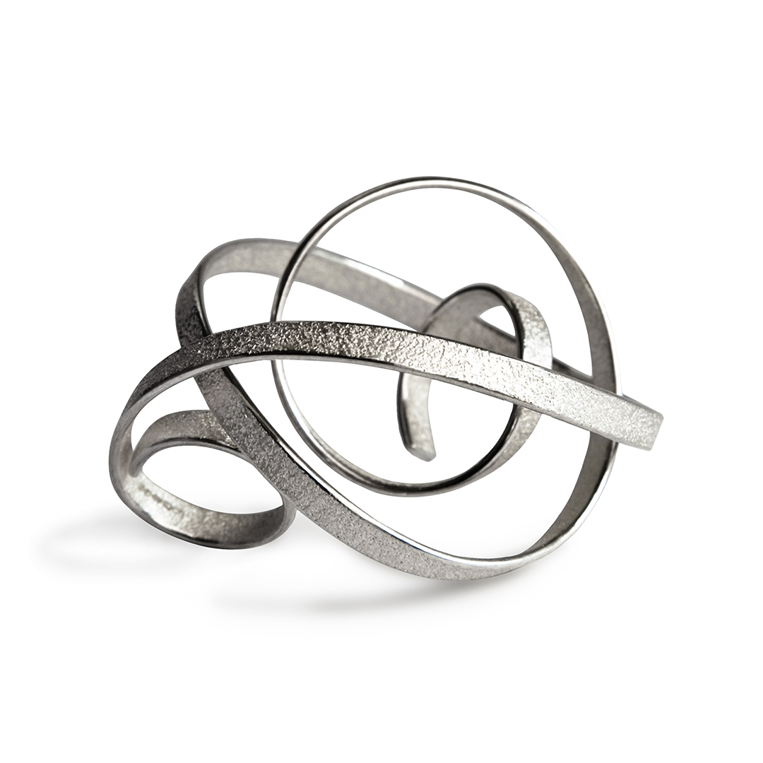Curling Crest of A Wave in recycled silver. Image Courtesy of U Decker