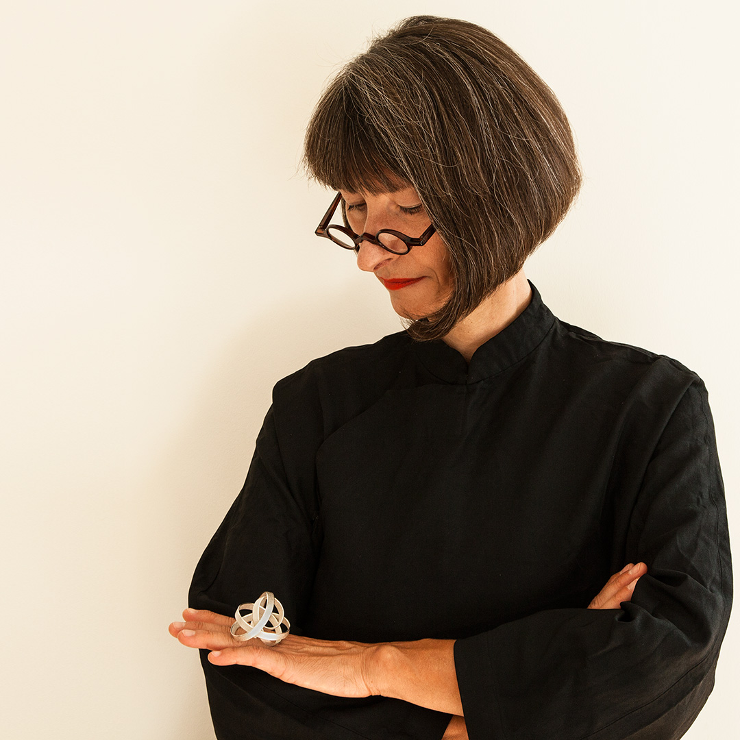 Portrait of Ute Decker wearing the Orbit Ring in recycled silver. Image Courtesy of U Decker