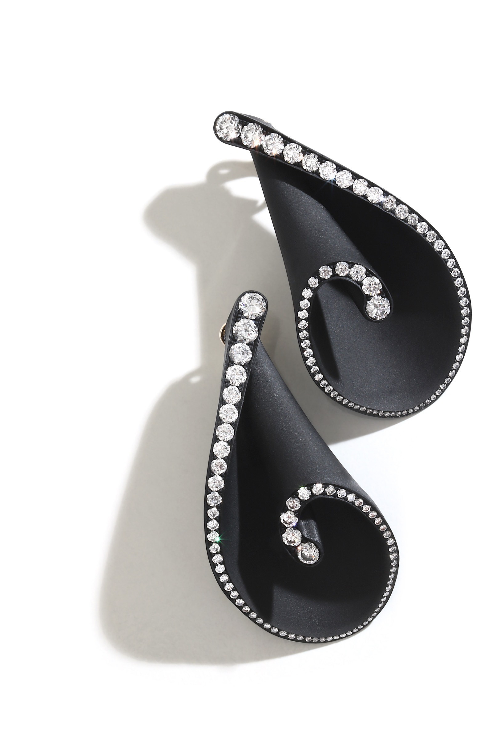 Seashell Earrings, Aluminium and Diamonds. Image Courtesy of Emmanuel Tarpin