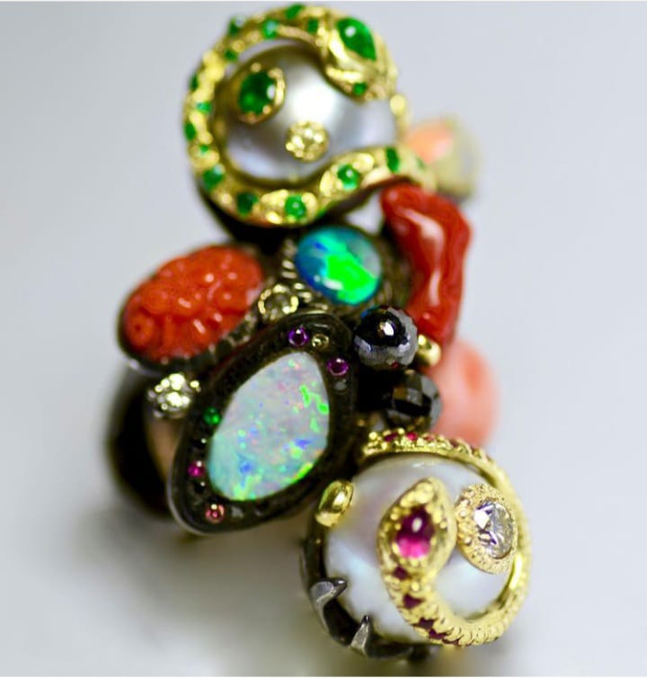 Serpentine Ring: Pearls, Opals, Emeralds, Rubies, Purple and Black Diamonds, Ebony. Image Courtesy of Castro NYC