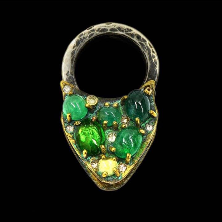 Infinity Lock, Tsavorites, Emeralds, Diamonds. Image Courtesy of Castro NYC